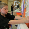 Ayers Ryal Side Elementary School 3rd grader Jared Flynn hangs up a sticky note with his goals for the upcoming school year on the bulletin board on the first day of school Tuesday afternoon. David Le/Staff Photo