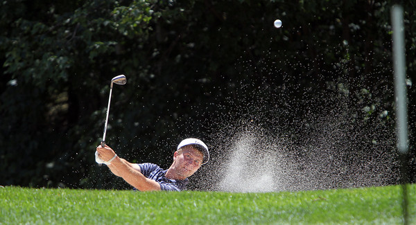 Eddie Hjerpe, of Barrington, RI, chips the ball out of a sand trap near the green on the 14th Hole at Ipswich Country Club during the Ouimet Memorial Tournament on Wednesday afternoon. David Le/Staff Photo