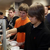 St. John's Prep sophomores Zack Pearce, left, Max Massaro, center, and Athamasi Kourkoulis, right, serve soup at St. John's Prep's Empty Bowls Dinner Party on Thursday night. David Le/Salem News
