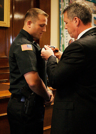 Beverly: Beverly Police Officer William Barror gets his Police Medal pinned on his collar by Beverly Police Chief Mark Gray in a ceremony held at Beverly City Hall on Tuesday evening for Barror's brave actions during an apartment fire on Mill Street on the 4th of July. Photo by David Le/Salem News