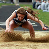 Hamilton-Wenham long jumper Taylor Teed lands a jump against Masco on Wednesday. David Le/Staff Photo