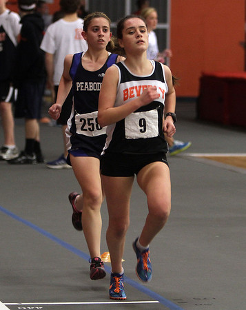 Beverly's Nicole Demars and Peabody's Antonia Pagliuca compete in the 2-mile race on Thursday afternoon. David Le/Salem News