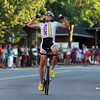 Ben Wolfe, winner of the Men's Elite division of the Beverly Gran Prix, pumps his fists in the air as he coasts down Cabot Street, well ahead of the rest of the field, and across the finish line on Wednesday evening. David Le/Staff Photo