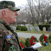 Guy Simmons, of the Beverly Civil Air Patrol Squadron reads a speech to a large crowd gathered at St. Mary of the Annunciation Cemetary on Saturday afternoon.David Le/Salem News