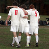 Masco's Tighe VanLenten (11) and Demetri DeCoulas (5) help Alex Brown (3) off the field after defeating Acton-Boxborough on Wednesday afternoon. David Le/Salem News