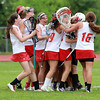 The Masco girls lacrosse team mobs goalie Lili Miller following a 11-7 victory over Beverly on Tuesday afternoon in the first round of the tournament. David Le/Staff Photo