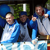 Danvers High School State Champions from left, senior George Merry, junior Nick McKenna, senior Jon Amico, and junior Nick Bates, wave from the back of a Salem Trolley while leading the Danvers Little League Parade on Saturday morning. David Le/Staff Photo