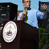 Salem: State Representative John Keenan addresses a large crowd at the opening ceremony for the Harborwalk in downtown Salem on Thursday afternoon. The Harborwalk runs along the South River basin from Congress Street to Layfayette Street. Photo by David Le/Salem News