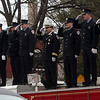 Peabody: Members of the Salem Fire Department stand on top of one of Peabody's ladder truck and salute as the engine carrying firefighter Jim Rice passes bye. David Le/Salem News