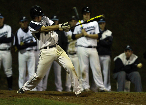 Peabody's George Tsonis makes contact against Danvers on Wednesday evening. David Le/Staff Photo
