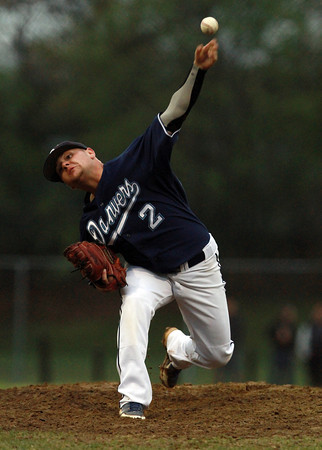 Danvers starting pitcher Ray Arocho fires a strike against Peabody on Wednesday night. David Le/Staff Photo