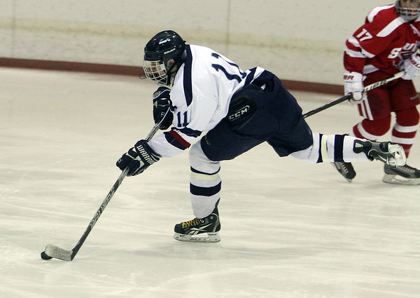 Peabody's Tommy Burns unleashes a wrist shot on net against Saugus on Wednesday night. David Le/Salem News