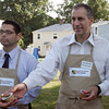 State Represenative Jerry Parisella, right, hands out food to customers at Beverly Boostraps' Mobile Market with Beverly City Councilor Jason Silva on Tuesday afternoon. David Le/Staff Photo