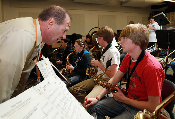 Longtime Beverly High School Band Director Ray Novack, left, talks with junior Ian Beckman during rehearsal on Tuesday afternoon. Novack is retiring after 34 years as director. David Le/Staff Photo