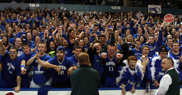 The Danvers High School fans explode as the Falcons celebrate their first D3 State Basketball Championship. David Le/Staff Photo