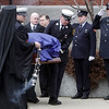 Peabody: Pall bearers carrying the casket of Peabody firefighter Jim Rice leave St. Vasilios Greek Orthodox Church on Friday morning. David Le/Salem News
