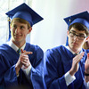 Waring School graduates Gus Mosse, of Gloucester, left, and Evan Supple, right, of Newbury, applaud classmate Rebecca Patey following her French Essay Reading on Friday afternoon. David Le/Staff Photo