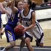 Gordon College senior Catey Marshall drives to the hoop against a WNEC defender. David Le/Salem News