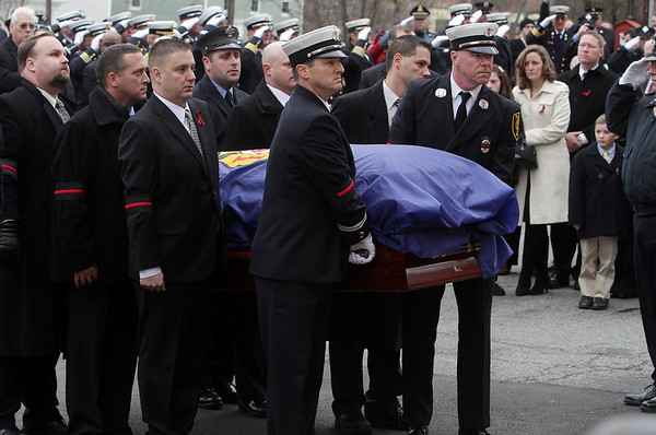 Peabody: Pall bearers carrying the casket of former Peabody firefighter Jim Rice prepare to enter St. Vasilios Greek Orthodox Church on Friday morning. David Le/Salem News