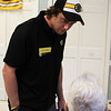 Peabody: Boston Bruins forward prospect Nick Tremblay talks with an elderly patient at the Pilgrim Rehabilitation Center in Peabody on Friday afternoon. Photo by David Le/Salem News