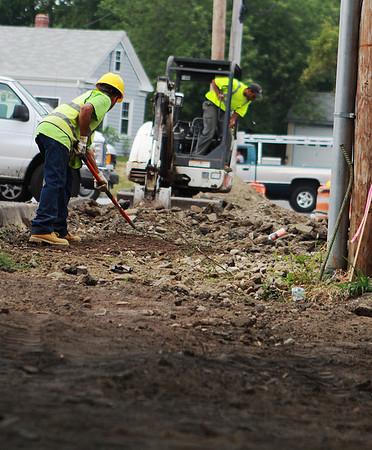 Danvers: Construction workers on Bates St. in Danvers work on repairing the road and sidewalk on Thursday afternoon. Photo by David Le/Salem News