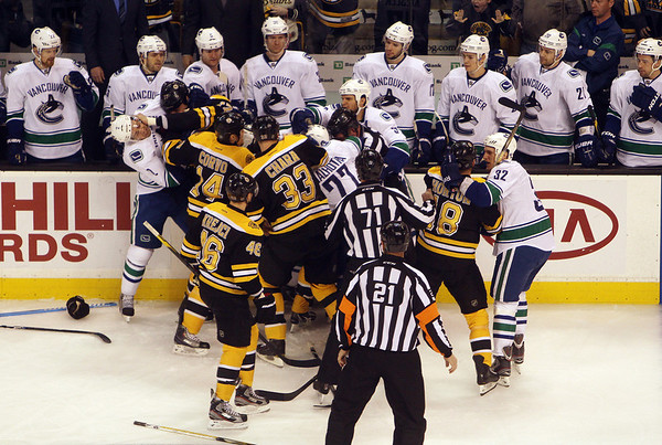 A wild melee ensued in front of the Vancouver bench after Boston Bruins forward Shawn Thornton and few Canucks exchanged some words, which led to an all out brawl in a rematch between the teams that met in the Stanley Cup last year. David Le/Salem News