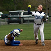 Peabody shortstop Katie Brunelle, right, steps around Danvers' Devyn Downs, and fires the ball to first to complete a double play. David Le/Staff Photo