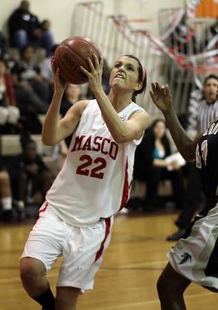 Masco junior Claudia Marsh goes up for a layup on Thursday night. David Le/Salem News