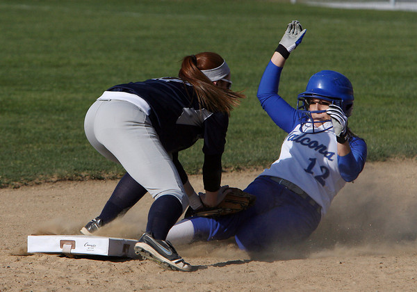 Swampscott second baseman Kelly Birchmore (17) left, applies the tag to Danvers' Julia Saggese (12) right, as she slides into the base. David Le/Staff Photo