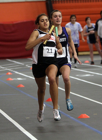 Beverly's Wendy Marciano, left, and Peabody's Sarah May battle for position during the final leg of the 4x400 meter relay. David Le/Salem News