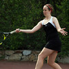 Marblehead freshman Tory Booth returns a serve against Salem during first singles play on Monday afternoon. David Le/Staff Photo