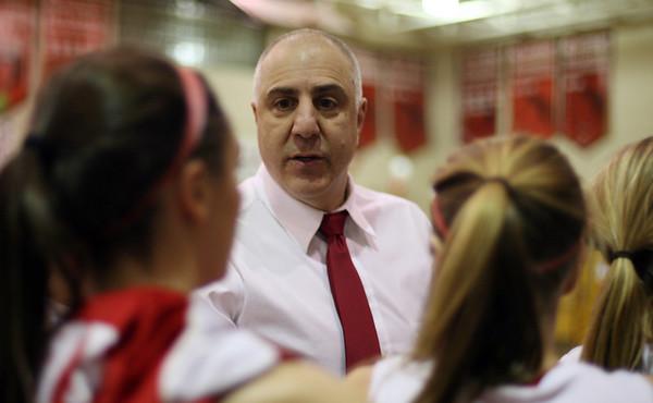 Masco head coach Bob Romeo speaks to his team during a timeout on Thursday night. David Le/Salem News
