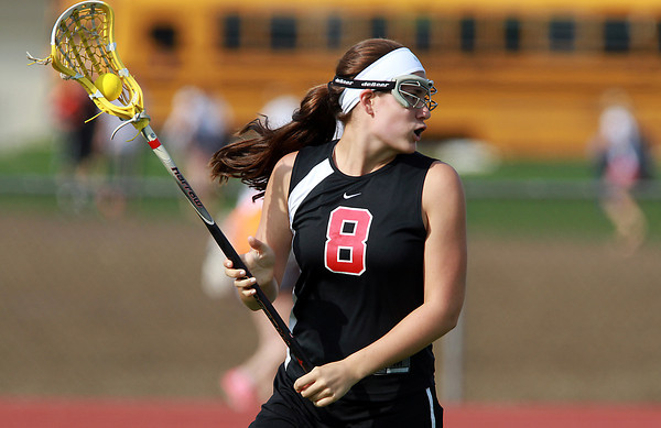 Marblehead attacker Pam Gregory lines up a shot on net against Beverly. Gregory paced the Magicians with 5 goals and Marblehead defeated Beverly 16-6 on Wednesday afternoon. David Le/Staff Photo