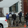 """The crew for a horror movie called """"Lords of Salem,"""" written and directed by Rob Zombie, worked through the rain to shoot on the corner of Essex and Hamilton Streets on Thursday afternoon. David Le/Salem News"""