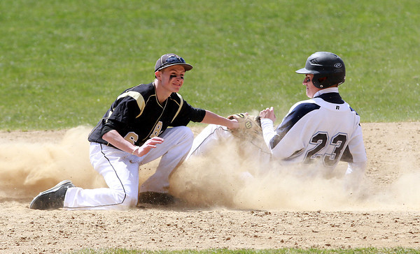Bishop Fenwick 2nd baseman Alex Petras looks at the umpire for the call after applying a tag to Peabody's Bobby Losano (23). David Le/Staff Photo