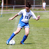 Danvers Girls U-14 Tornados player McKenzie Plaza crosses the ball into the box against Woburn on Monday morning during the Danvers Invitational Tournament.David Le/Staff Photo