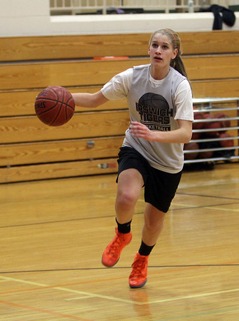 Ipswich's Caroline Soucy drives to the basket during practice. David Le/Salem News