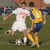 Masco's Justin Clark boots a ball upfield while being pressured by an Acton-Boxborough defender. David Le/Salem News