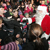 Santa Claus shakes hands with many children that turned out to see him at the Hawthorne Hotel in Salem on Friday night. David Le/Salem News
