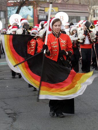 A member of the Beverly High School marching band color guard waves her flag during the annual Beverly Holiday Parade. David Le/Salem News