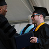 Endicott College graduate Jared Rizzo, of Peabody, shakes hands with Commencement Honorary speaker Salome Thomas-EL, after receiving his diploma on Saturday morning. David Le/Staff Photo