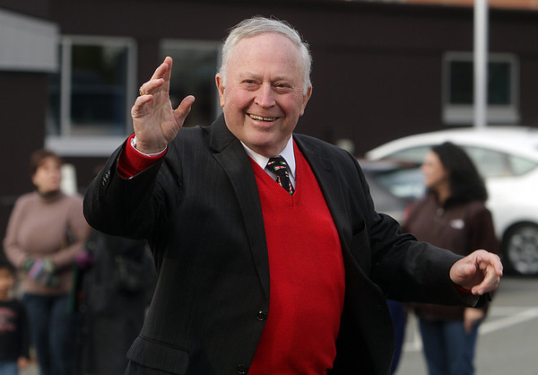 Mayor of Beverly Bill Scanlong waves to spectators along Elliot Street during the annual Holiday Parade on Sunday afternoon. David Le/Salem News