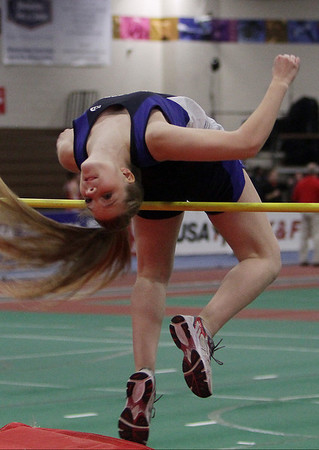 Peabody high jumper Laura Pelletrino arches her back to clear the bar at the NEC Conference Meet at Reggie Lewis Center in Roxbury. David Le/Salem News