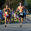 Two runners sprint down the hill at Lynch Park and towards the finish line in the 45th Annual Beverly Homecoming Road Race on Thursday evening. David Le/Staff Photo