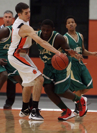 Beverly: Beverly'sDan Cacciatore (31) left, reaches in and steals the ball from Lynn Classical's Moise Builou (11) right, on Tuesday night. David Le/Salem News