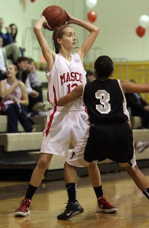Masco's Hannah Kiernan (12) left, looks to pass around a Cambridge defender. David Le/Salem News
