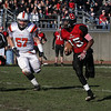 Salem High School quarterback Christian Dunston (15) right, rolls out of the pocket while being pursued by Beverly's Marc Babcock on Thanksgiving Day. David Le/Salem News