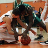 Beverly: Beverly's Dan Cacciatore, left, and Lynn Classical's Uche Nwokeji , right, battle for a loose ball on Tuesday night., David Le/Salem News