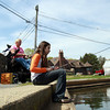 Olivia Binette, 11, of Salem, right, fishes at Redd's Pond in Marblehead while visiting her grandmother Raylene Charest, of Marblehead, left, on a warm Friday afternoon. David Le/Staff Photo