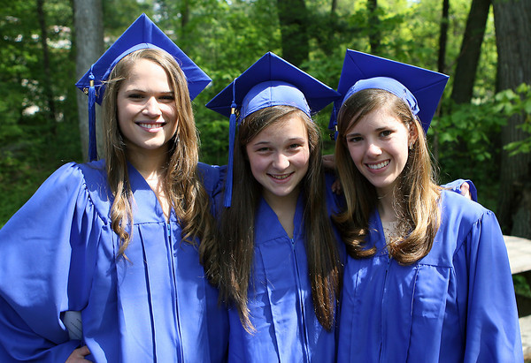 Waring School graduates Megan Clasby, of Marblehead, Maggie Sheetz, of Topsfield, and Emily Glaenzer, of Manchester, pose for a photo before their Commencement ceremony on Friday afternoon. David Le/Staff Photo